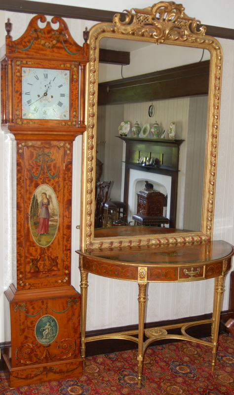 Lovely longcase clock in satinwood with white dial and painted scenes