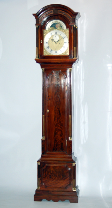 Lovely mahogany veneers and case features of this top quality London clock by James Clarke