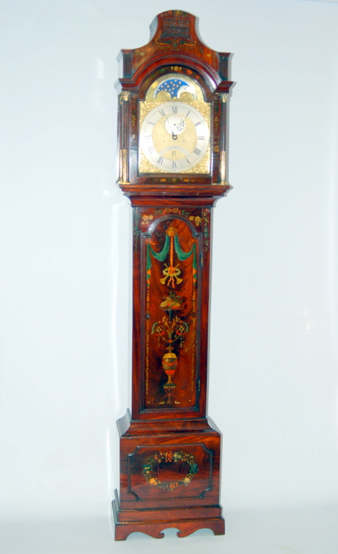 Ached brass dial moon longcase clock with case of London design but finely decorated with flowers and  urns