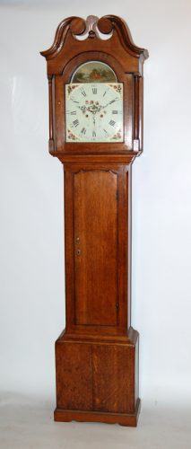 Rare oak clock by Barber Winster