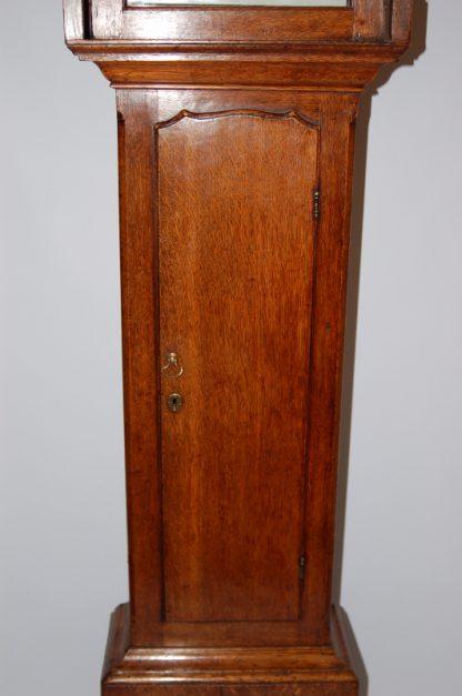 Long oak trunk door barber clock